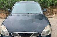 Bán ô tô Daewoo Nubira năm 2001, màu đen xe gia đình, giá tốt giá 32 triệu tại Lào Cai