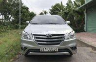 Bán Toyota Innova E đời 2014, màu bạc xe gia đình, giá tốt giá 498 triệu tại Tiền Giang