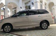 Bán Toyota Innova 2.0E MT đời 2015, màu vàng xe gia đình giá 524 triệu tại Tiền Giang