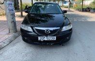 Cần bán xe Mazda 6 sản xuất năm 2003, màu đen số sàn, giá 225tr giá 225 triệu tại Bình Dương