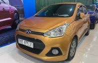 Cần bán lại xe Hyundai Grand i10 1.2AT năm 2016, màu vàng, nhập khẩu   giá 379 triệu tại Hà Nội