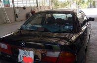 Bán Mazda 323 GLXi 1.6 MT đời 2000, màu đen, xe nhập   giá 115 triệu tại Hà Tĩnh