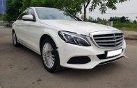Bán xe cũ Mercedes C250 Exclusive đời 2015, màu trắng giá 1 tỷ 130 tr tại Tp.HCM