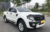 Cần bán lại xe Ford Ranger Wildtrak 3.2L 4x4 AT đời 2014, màu trắng, nhập khẩu chính hãng giá 595 triệu tại Hà Nội