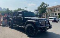 Bán Jeep Wrangler Unlimited Sport 3.6 AT sản xuất 2015, màu đen, xe nhập giá 2 tỷ 850 tr tại Hà Nội
