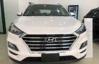 Bán xe chính hãng chiếc xe Hyundai Tucson sản xuất năm 2019, màu trắng giá 771 triệu tại Hà Nội