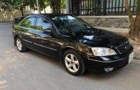 Cần bán xe Ford Mondeo 2.0 AT năm sản xuất 2004, màu đen, 200tr giá 200 triệu tại Hà Nội