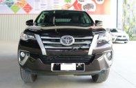 Cần bán lại xe Toyota Fortuner 2.4G 4x2 MT sản xuất 2018, màu nâu, xe nhập giá 990 triệu tại Tp.HCM