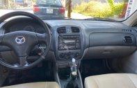 Cần bán Mazda 323 sản xuất 2003, màu trắng giá 165 triệu tại Bình Dương