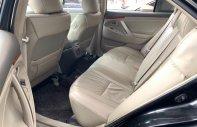 Cần bán Toyota Camry 2.4G năm 2010, màu đen xe gia đình giá 570 triệu tại Khánh Hòa