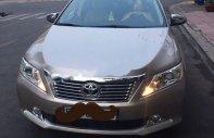 Cần bán xe Toyota Camry đời 2014, màu vàng xe còn mới lắm giá 748 triệu tại Tp.HCM