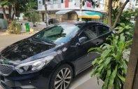 Cần bán lại xe Kia K3 AT đời 2013, màu đen, 470tr giá 470 triệu tại Tp.HCM
