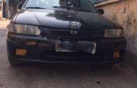 Cần bán gấp Mazda 323 năm sản xuất 1997, màu đen, xe nhập chính hãng giá 69 triệu tại Hòa Bình