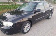 Cần bán Kia Spectra đời 2005, màu đen  giá 120 triệu tại Nghệ An