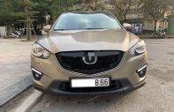 Cần bán Mazda CX 5 2.0 AT 2WD đời 2014, màu ghi vàng giá 665 triệu tại Hà Nội