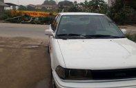 Bán xe Toyota Corolla năm 1990, màu trắng, nhập khẩu nguyên chiếc giá 58 triệu tại Thanh Hóa