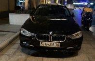 Cần bán lại xe BMW 3 Series 320i đời 2013, màu đen, xe nhập chính chủ giá 716 triệu tại Tp.HCM