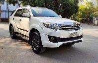 Bán Toyota Fortuner đời 2014, màu trắng giá 695 triệu tại Hà Nội