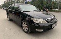 Bán Toyota Camry MT đời 2002, màu đen giá 238 triệu tại Hà Nội