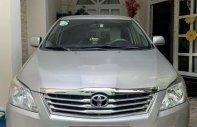 Cần bán Toyota Innova năm 2014, màu bạc chính chủ giá 410 triệu tại Tp.HCM