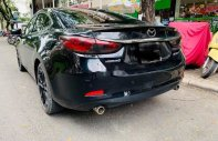 Cần bán gấp Mazda 5 năm 2016, màu đen, giá 670tr giá 670 triệu tại Tp.HCM