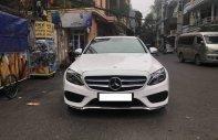 Bán xe Mercedes C300 AMG sản xuất năm 2015, màu trắng giá 1 tỷ 220 tr tại Hà Nội
