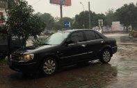 Cần bán xe Ford Laser đời 2004, màu đen, số tự động giá 248 triệu tại Đắk Lắk