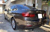 Cần bán xe BMW 3 Series 320i đời 2013, màu nâu, nhập khẩu giá 800 triệu tại Tp.HCM