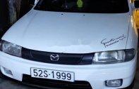 Bán Mazda 323 MT đời 1998, màu trắng giá 90 triệu tại Long An