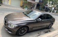 Cần bán lại xe BMW 3 Series sản xuất 2014, màu nâu, nhập khẩu, giá chỉ 835 triệu giá 835 triệu tại Tp.HCM
