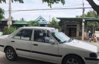 Bán ô tô Mazda 323F sản xuất 1999, màu trắng chính chủ, 30 triệu giá 30 triệu tại Tp.HCM