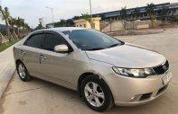 Cần bán Kia Forte EX 1.6 MT đời 2011, màu vàng, giá 295tr giá 295 triệu tại Hải Dương