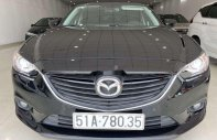 Cần bán xe cũ Mazda 6 năm sản xuất 2014, màu đen giá 680 triệu tại Tp.HCM
