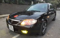Bán xe Mazda 323 năm 2002, màu đen, nhập khẩu nguyên chiếc chính chủ giá 127 triệu tại Hà Nội