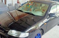 Bán Mazda 323 sản xuất năm 2000, màu đen, giá chỉ 86 triệu giá 86 triệu tại Tp.HCM