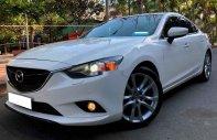 Bán ô tô Mazda 6 đời 2014, màu trắng, giá tốt giá 605 triệu tại Tp.HCM