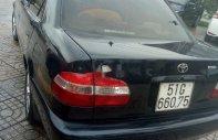 Cần bán lại xe Toyota Corolla MT năm 2000, màu đen chính chủ giá 160 triệu tại Tp.HCM