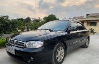 Cần bán gấp Kia Spectra đời 2003, màu đen, giá chỉ 99 triệu giá 99 triệu tại Hà Nội