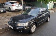 Cần bán Ford Laser GHIA 1.8 AT năm sản xuất 2003, màu đen số tự động giá 190 triệu tại Tp.HCM