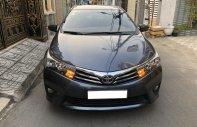 Mình bán Toyota Altis 2015, tự động 1.8, màu xám xanh giá 548 triệu tại Tp.HCM